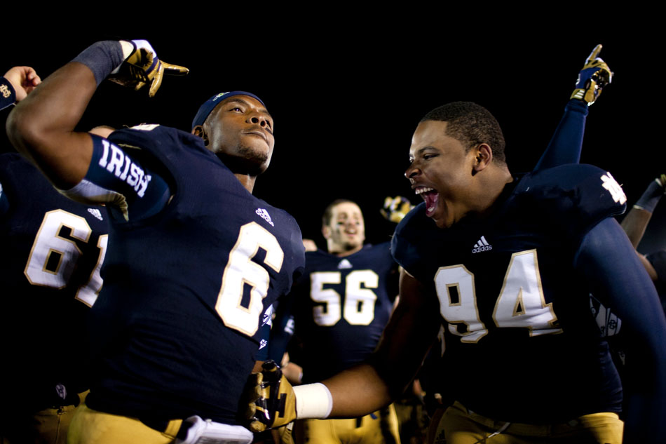 Notre Dame running back Theo Riddick (6) and defensive end Jarron Jones (94) celebrate a 29-26 win against Pittsburgh in three overtimes on Saturday, Nov. 3, 2012, at Notre Dame. (James Brosher/South Bend Tribune)