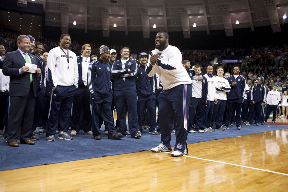 Before addressing the crowd, defensive end and team captain Kapron Lewis-Moore busts a quick dance move during the pep rally on Friday, Nov. 16, 2012, at the Purcell Pavilion at Notre Dame. (James Brosher/South Bend Tribune)