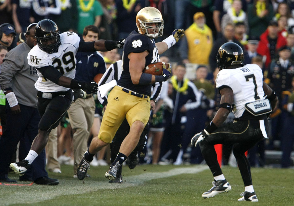 Wake Forest linebacker Justin Jackson, left, drags Notre Dame tight end Tyler Eifert out of bounds during an NCAA college football game on Saturday, Nov. 17, 2012, at Notre Dame. (James Brosher/South Bend Tribune)