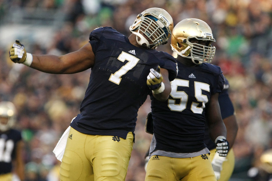 Notre Dame defensive end Stephon Tuitt (7) celebrates a sack with teammate linebacker Prince Shembo (55) during an NCAA college football game on Saturday, Nov. 17, 2012, at Notre Dame. (James Brosher/South Bend Tribune)