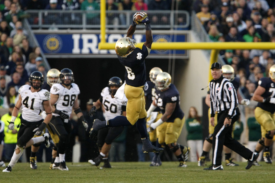 Notre Dame running back Theo Riddick (6) grabs a long reception over the middle during an NCAA college football game on Saturday, Nov. 17, 2012, at Notre Dame. (James Brosher/South Bend Tribune)