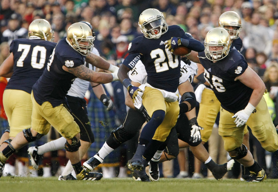 Notre Dame running back Cierre Wood (20) finds a hole during an NCAA college football game on Saturday, Nov. 17, 2012, at Notre Dame. (James Brosher/South Bend Tribune)