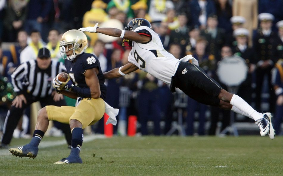 Wake Forest cornerback Kevin Johnson (9) tries to tackle Notre Dame wide receiver TJ Jones after a reception during an NCAA college football game on Saturday, Nov. 17, 2012, at Notre Dame. (James Brosher/South Bend Tribune)