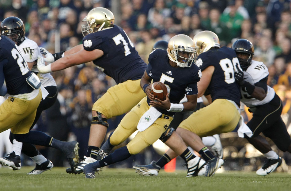 Notre Dame quarterback Everett Golson (5) rolls out off of play action during an NCAA college football game on Saturday, Nov. 17, 2012, at Notre Dame. (James Brosher/South Bend Tribune)