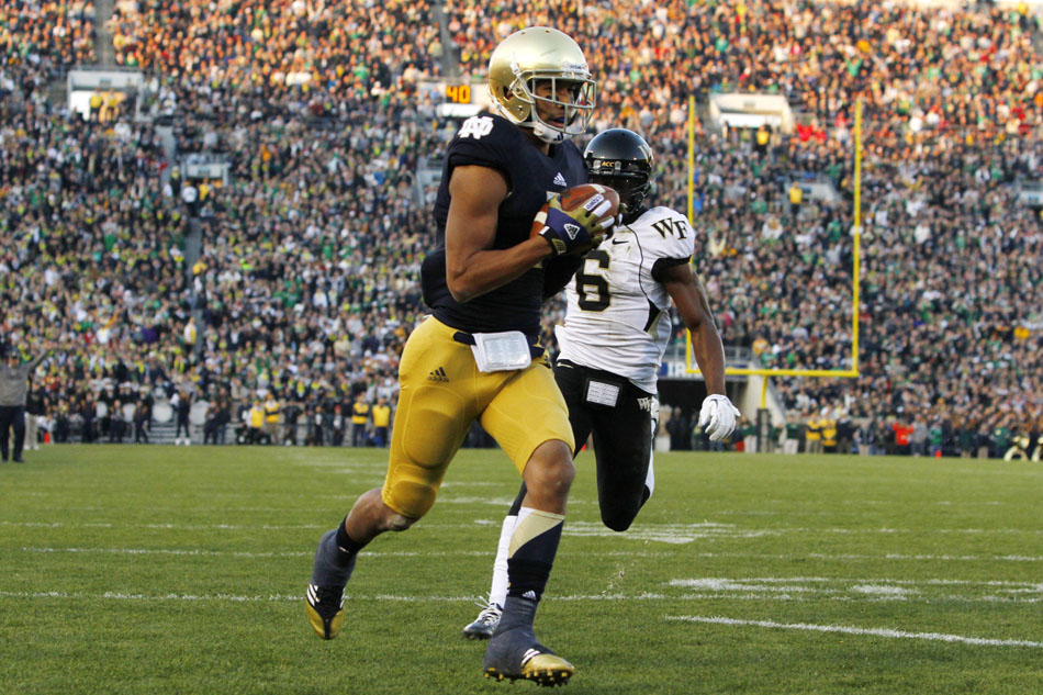 Notre Dame wide receiver TJ Jones (7) catches a touchdown in front of Wake Forest cornerback Chibuikem Okoro (6) during an NCAA college football game on Saturday, Nov. 17, 2012, at Notre Dame. (James Brosher/South Bend Tribune)