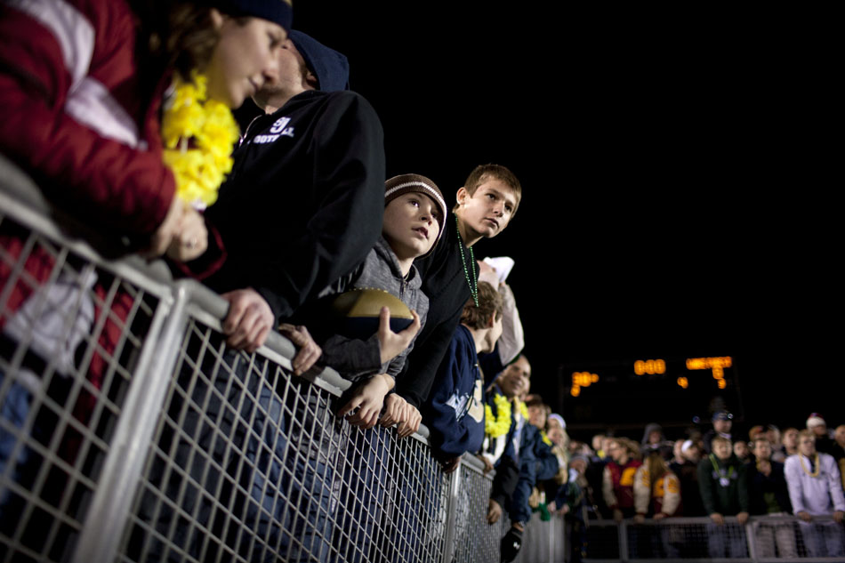 Youngsters wait in the tunnel for a glimpse of players as they run off the field after an NCAA college football game between Notre Dame and Wake Forest on Saturday, Nov. 17, 2012, at Notre Dame. (James Brosher/South Bend Tribune)
