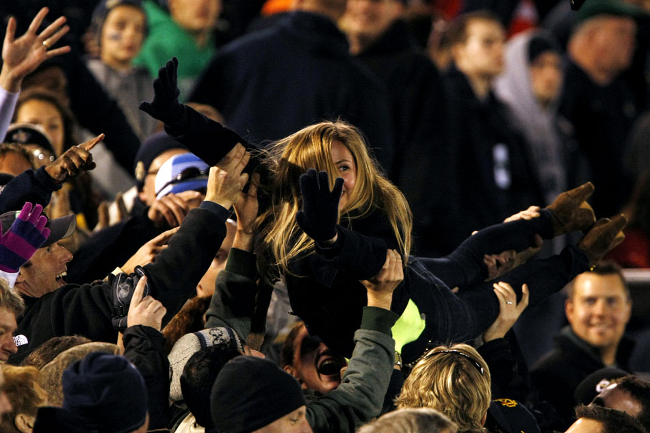 A Notre Dame fan does push ups in the stands after a touchdown during an NCAA college football game on Saturday, Nov. 17, 2012, at Notre Dame. (James Brosher/South Bend Tribune)
