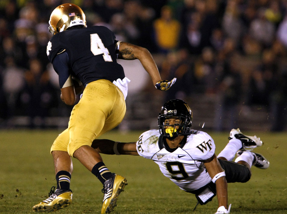 Wake Forest cornerback Kevin Johnson (9) lays out as he tries to tackle Notre Dame running back George Atkinson III (4) during an NCAA college football game on Saturday, Nov. 17, 2012, at Notre Dame. (James Brosher/South Bend Tribune)