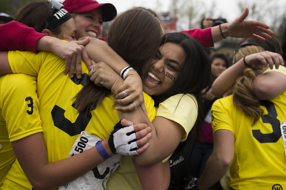 Kappa Alpha Theta fans swarm their riders after the team won the Women's Little 500 on Friday, April 24, 2015, at Bill Armstrong Stadium. (James Brosher/IU Communications)