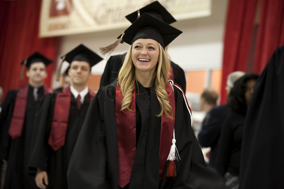 A graduate smiles as she walks in the processional during IU Kokomo Commencement on Tuesday, May 12, 2015, at Ivy Tech in Kokomo. (James Brosher/IU Communications)