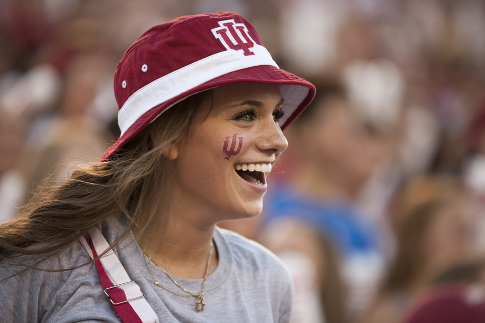 Elisa Krebs, a First Year Experiences student staffer, shares a smile during Traditions and Spirit of IU on Friday, Aug. 21, 2015, at Memorial Stadium. (James Brosher/IU Communications)