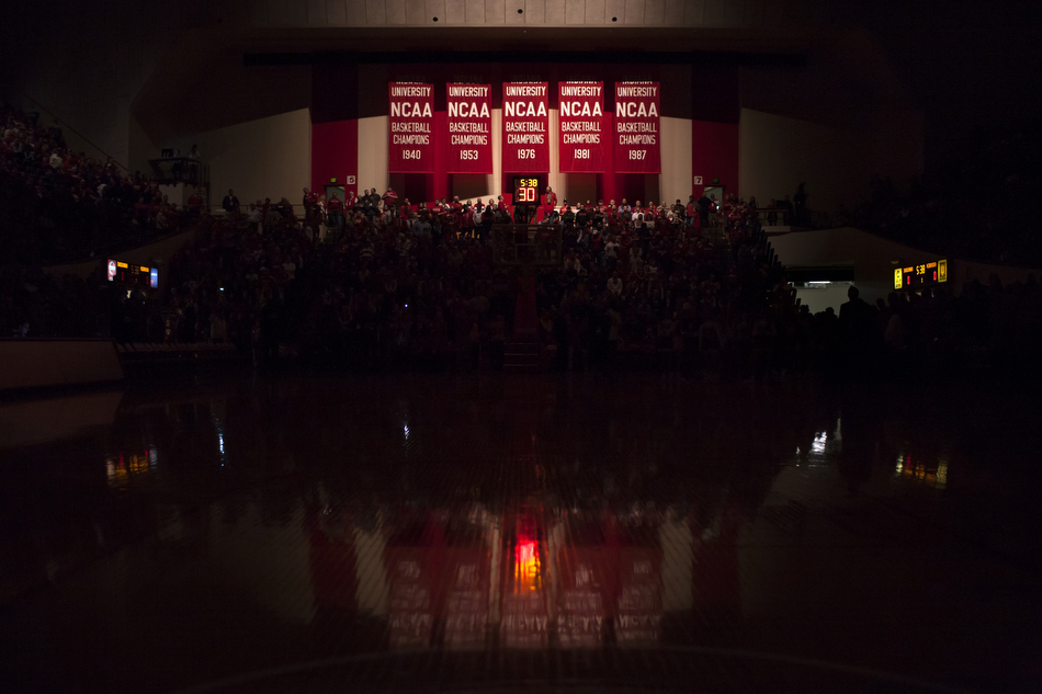 Indiana's national championship banners are illuminated by spotlights before players make their way to the court for a NCAA men's basketball game against Nebraska on Wednesday, Feb. 17, 2016, at Assembly Hall in Bloomington. (James Brosher/IU Communications)