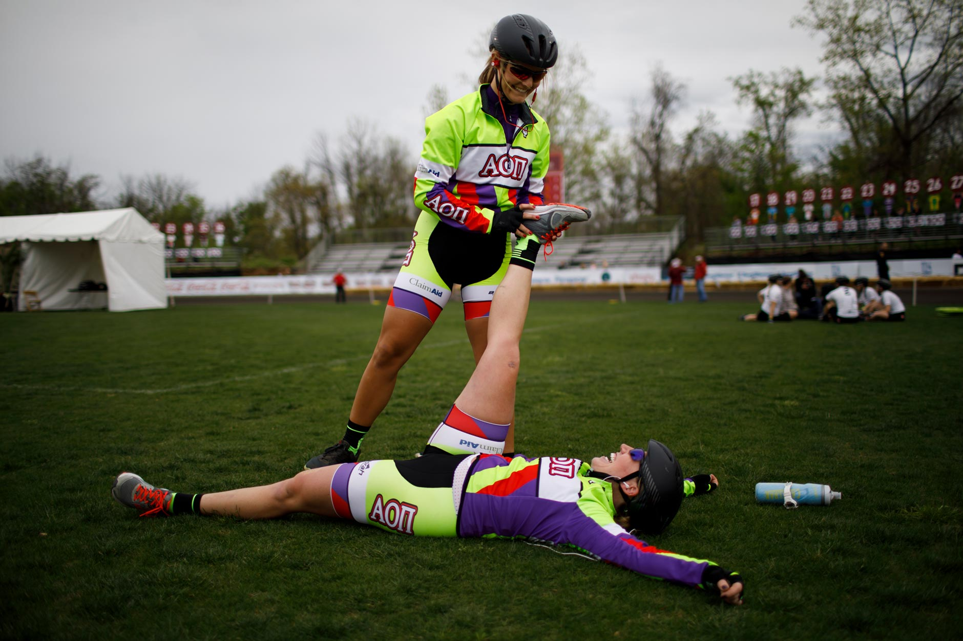 Alpha Omicron Pi rider Audrey Healey, top, stretches out teammate Kaci Garrity before the Women's Little 500 at Bill Armstrong Stadium on Friday, April 21, 2017. (James Brosher/IU Communications)