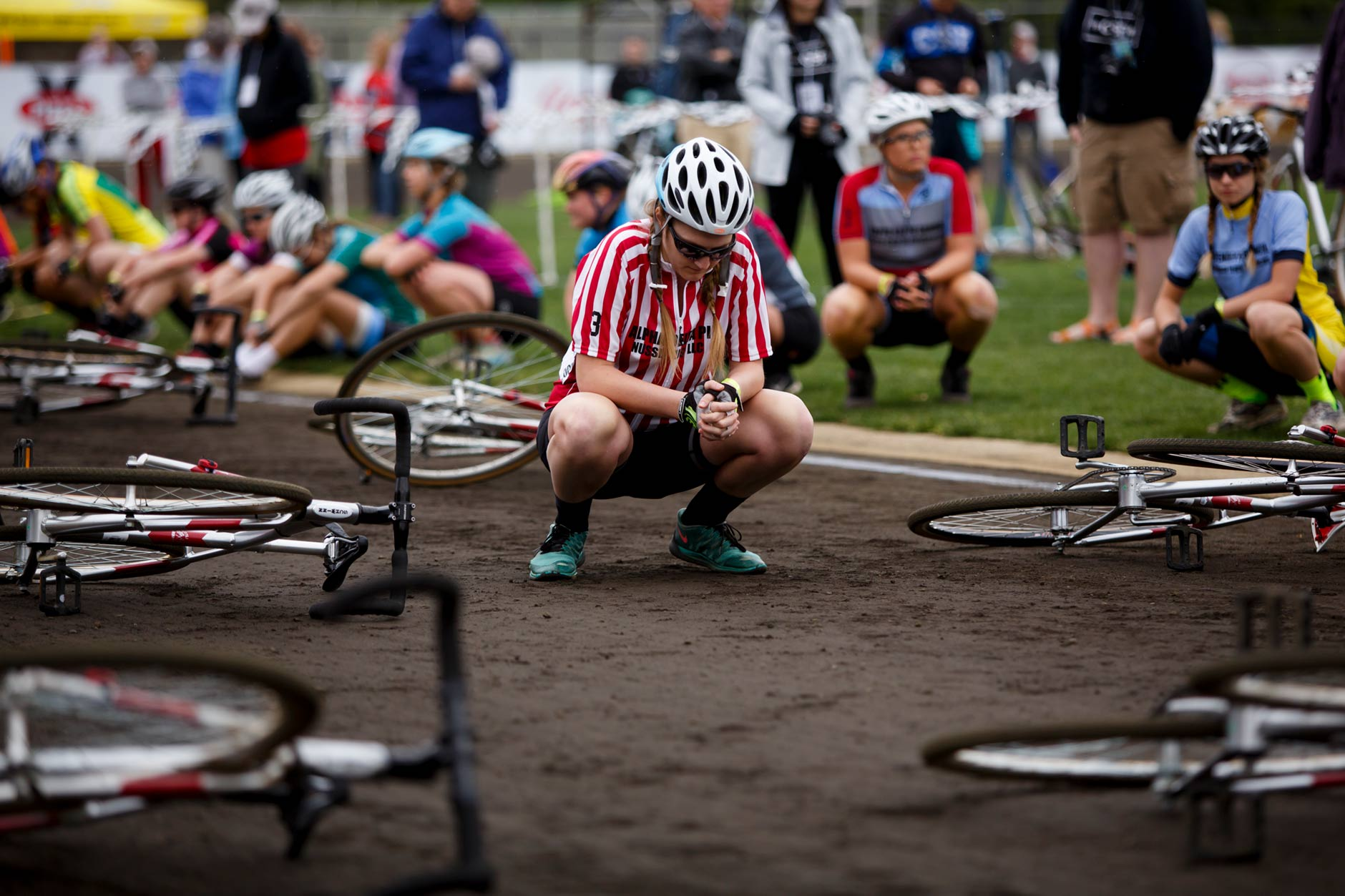 Alpha Delta Pi rider Abby Messenger bows her head during an invocation before the Women's Little 500 at Bill Armstrong Stadium on Friday, April 21, 2017. (James Brosher/IU Communications)