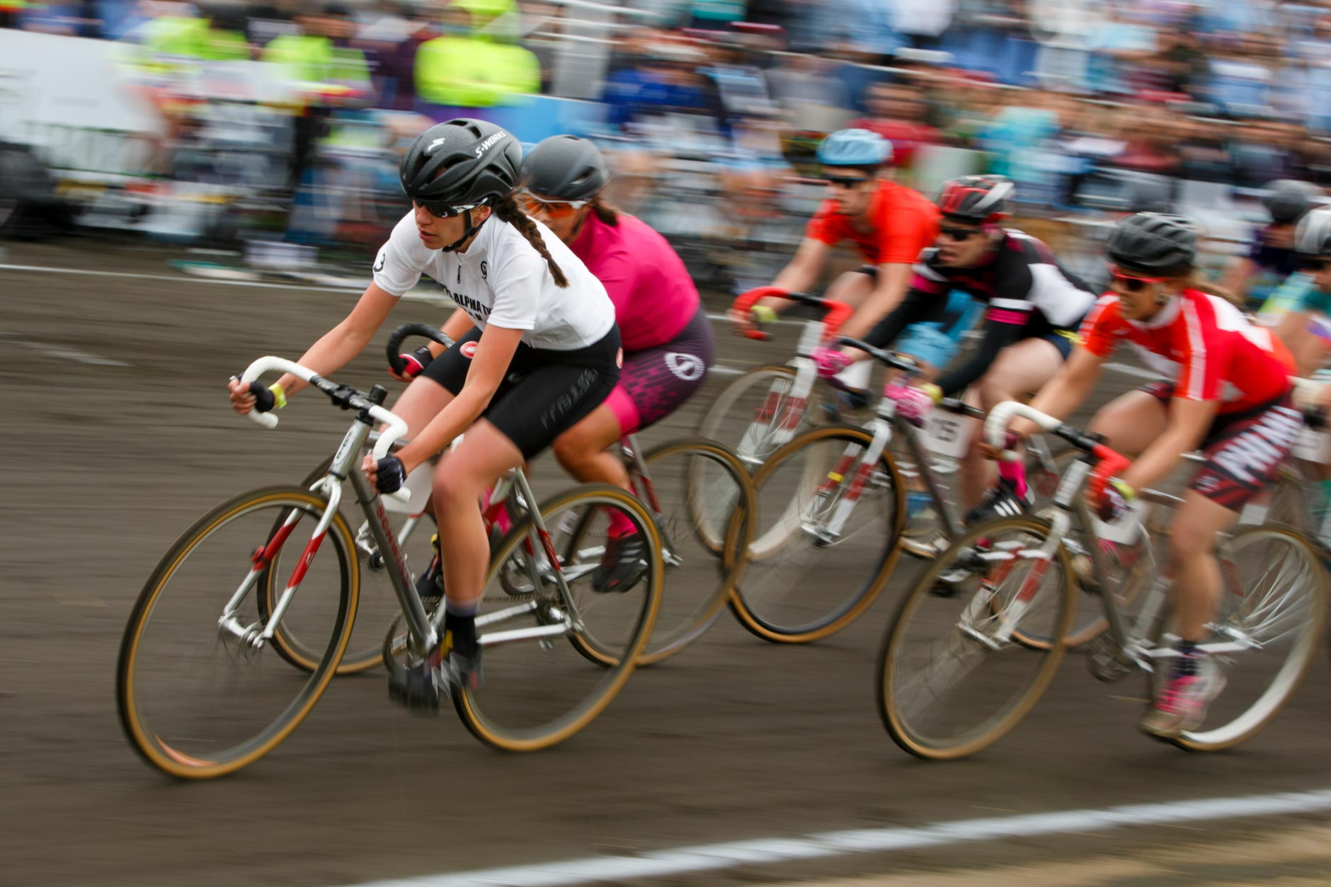 Kappa Alpha Theta's Evelyn Malcomb, left, leads a pack of riders during the Women's Little 500 at Bill Armstrong Stadium on Friday, April 21, 2017. (James Brosher/IU Communications)