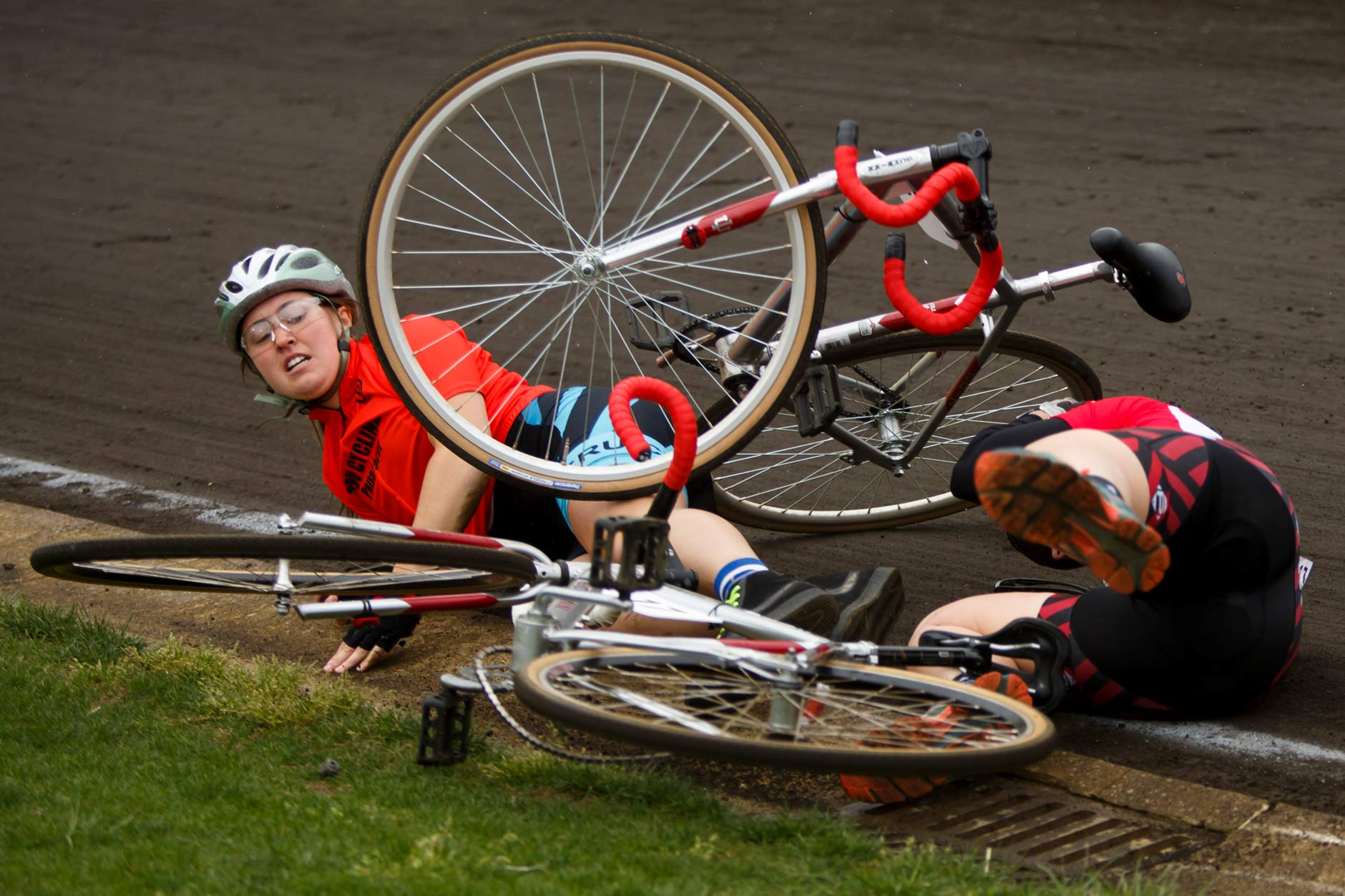 Cru Cycling rider Emma McCardwell, left, falls to the cinder as she wrecks with Phi Mu rider Abby Vehrs during the Women's Little 500 at Bill Armstrong Stadium on Friday, April 21, 2017. (James Brosher/IU Communications)