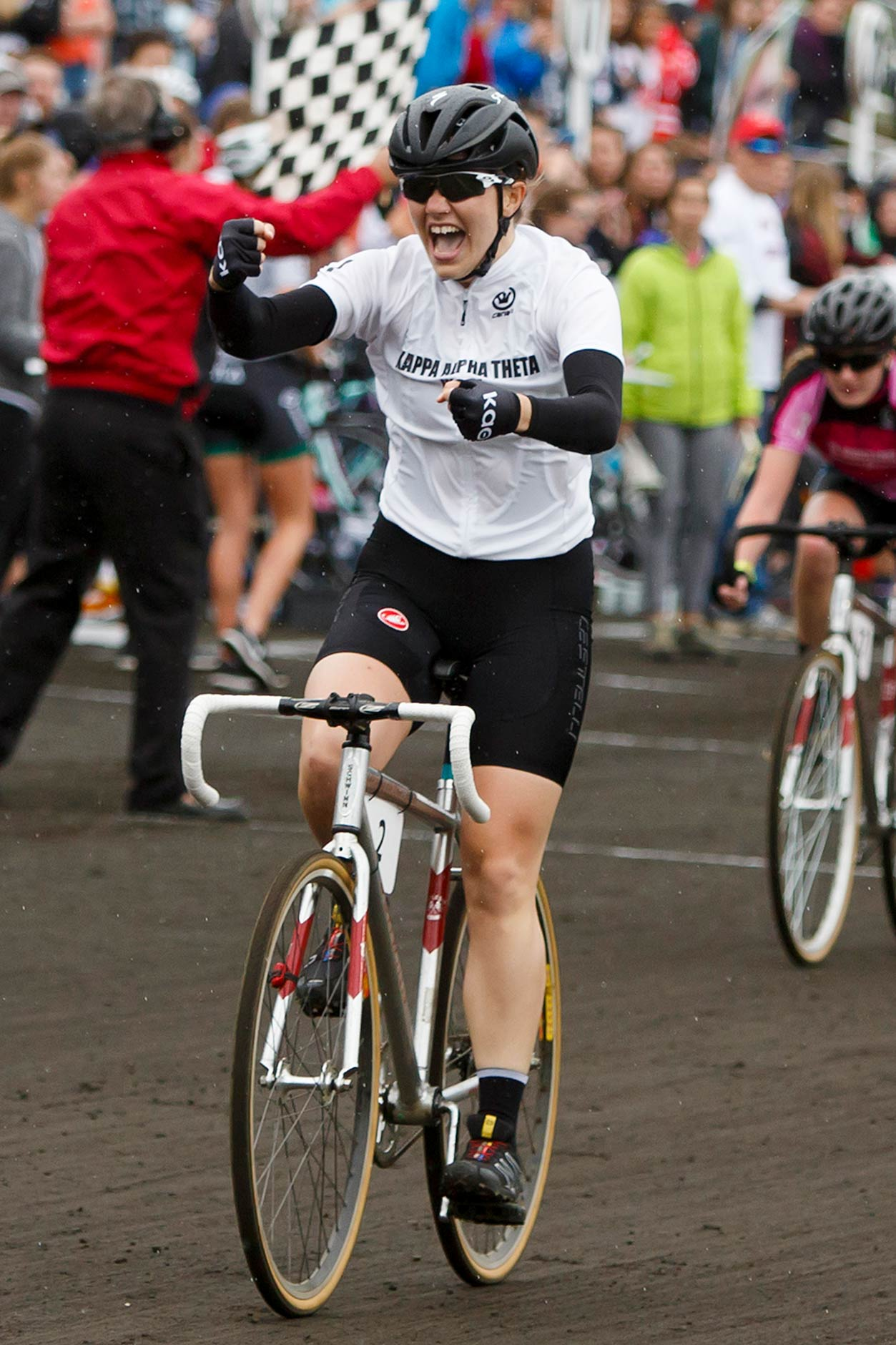 Kappa Alpha Theta's Grace Bennett celebrates as she rides to a victory in the Women's Little 500 at Bill Armstrong Stadium on Friday, April 21, 2017. (James Brosher/IU Communications)