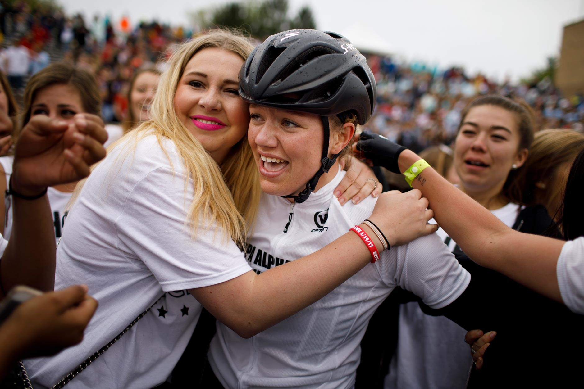 Sorority sisters swarm Kappa Alpha Theta rider Grace Bennett after the team won the Women's Little 500 at Bill Armstrong Stadium on Friday, April 21, 2017. (James Brosher/IU Communications)