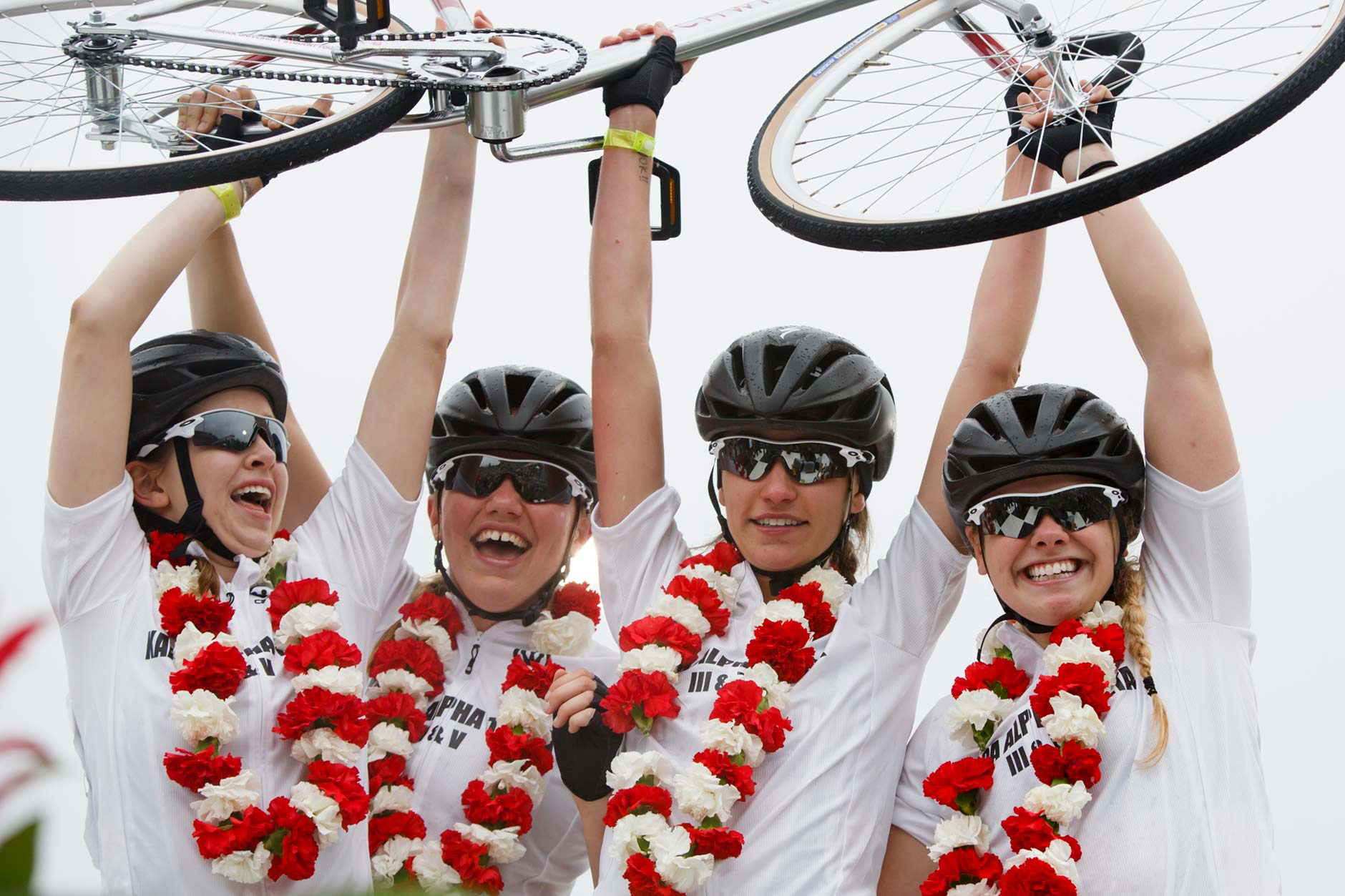 Kappa Alpha Theta riders Rachel Brown, left, Grace Bennett, left, Evelyn Malcomb and Sydney Keaton celebrate their victory in the Women's Little 500 at Bill Armstrong Stadium on Friday, April 21, 2017. (James Brosher/IU Communications)
