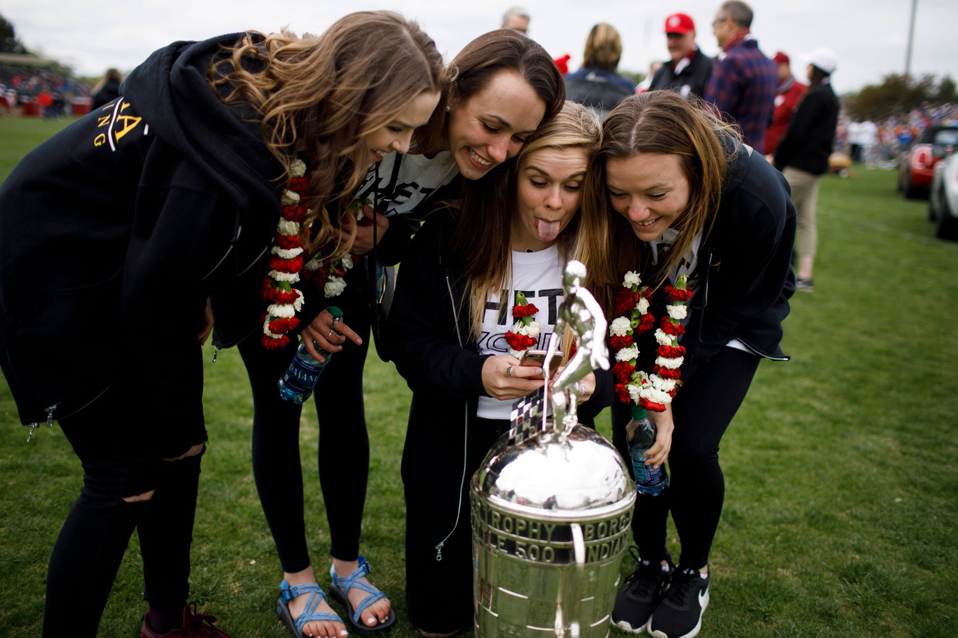 Kappa Alpha Theta riders Rachel Brown, left, Evelyn Malcomb, Sydney Keaton and Grace Bennett take a selfie with the Borg-Warner Trophy before the Men's Little 500 at Bill Armstrong Stadium on Saturday, April 22, 2017. Kappa Alpha Theta won the Women's Little 500 on Friday afternoon. (James Brosher/IU Communications)