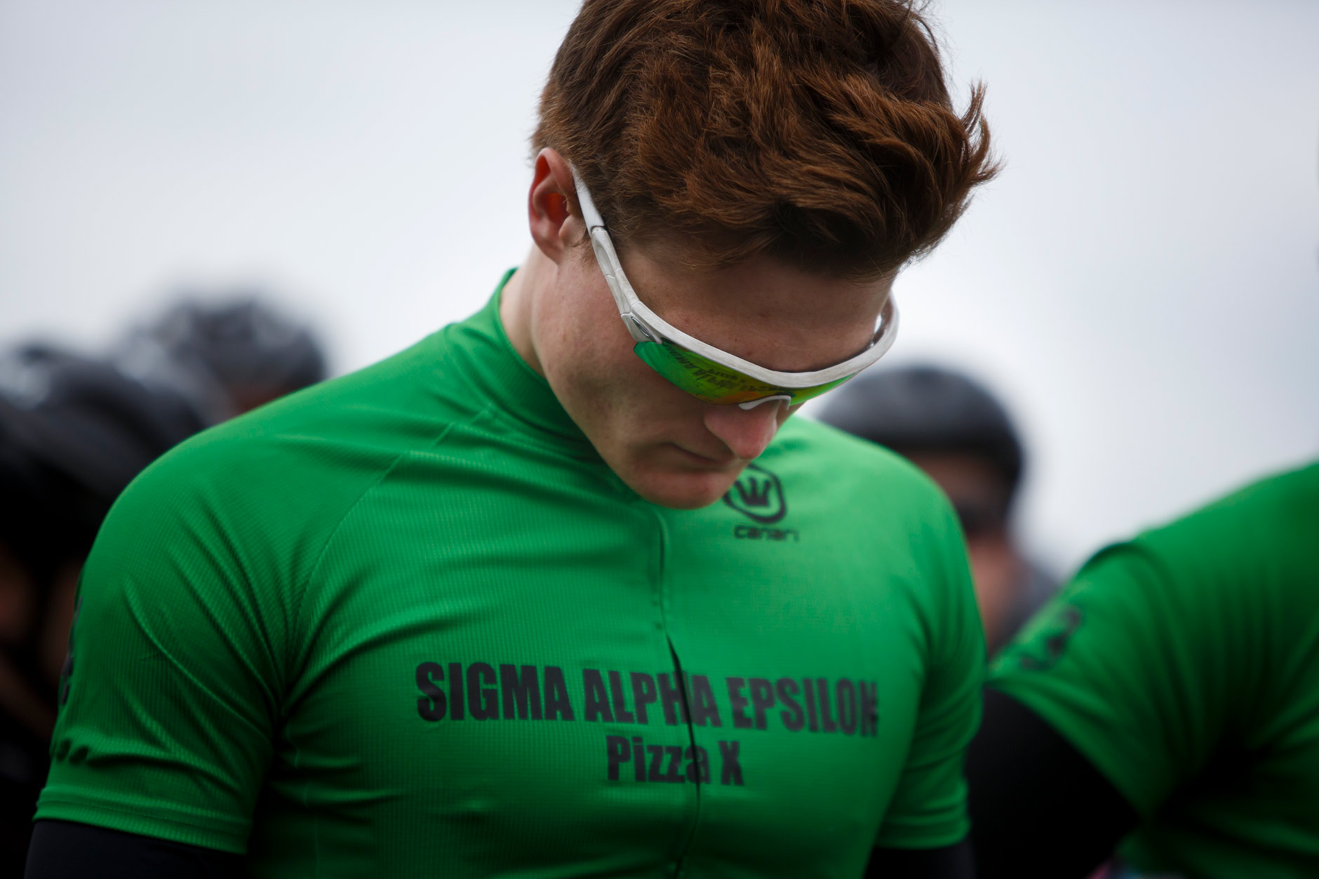 Sigma Alpha Epsilon's Ryan Tuffnell bows his head as he and his teammates wait for the start of team introductions before the Men's Little 500 at Bill Armstrong Stadium on Saturday, April 22, 2017. (James Brosher/IU Communications)