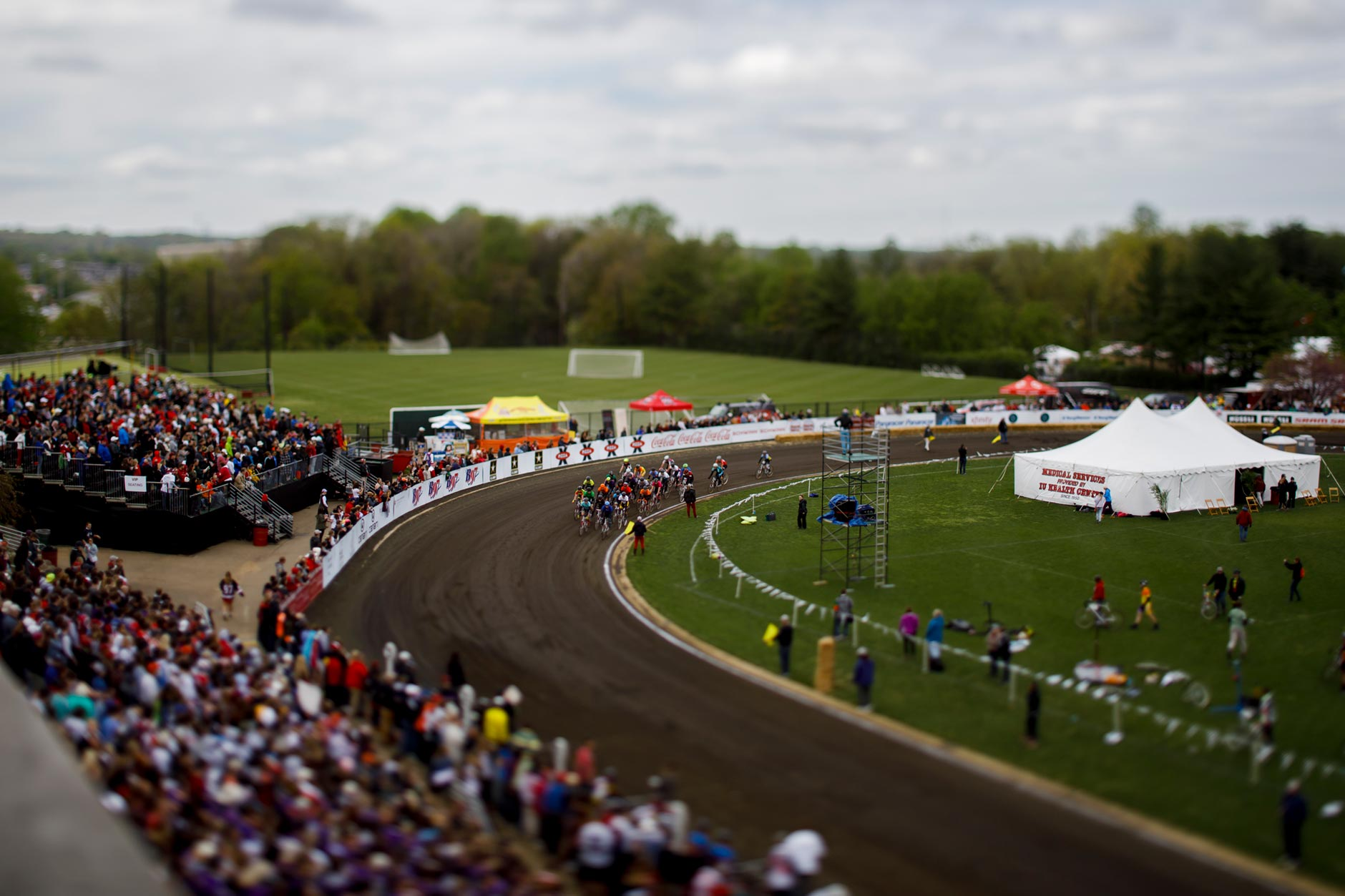 A pack of riders make their way out of turn four under the yellow flag during the Men's Little 500 at Bill Armstrong Stadium on Saturday, April 22, 2017. (James Brosher/IU Communications)