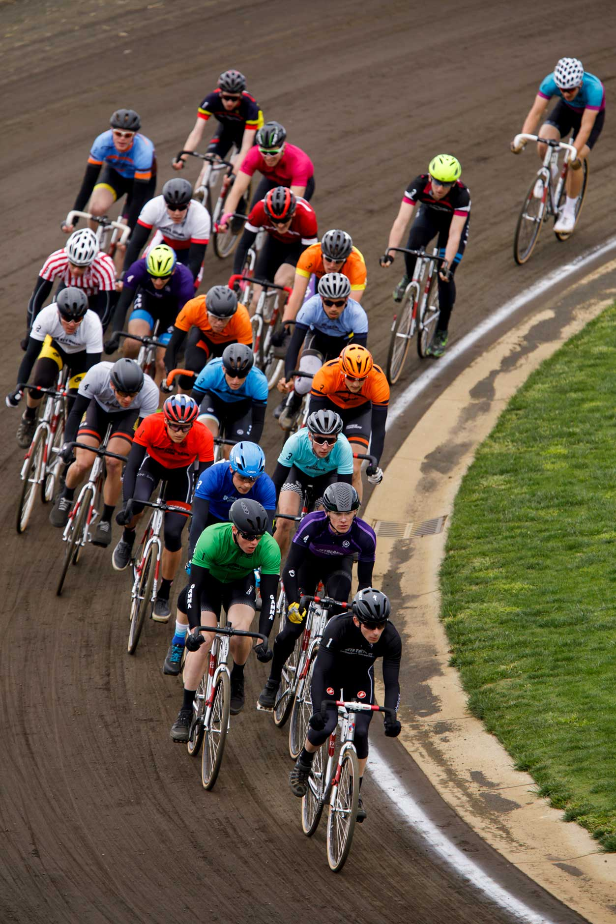 Riders race through turn four during the early laps of the Men's Little 500 at Bill Armstrong Stadium on Saturday, April 22, 2017. (James Brosher/IU Communications)