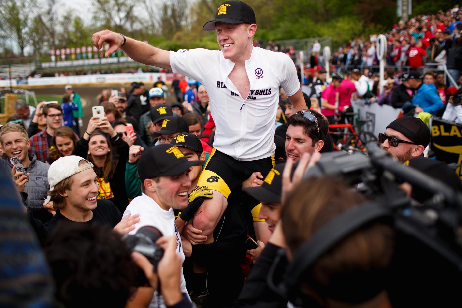 Fans carry Black Key Bulls rider Kevin Mangel out of the team's pit area after Mangel rode the final leg of his team's victory in the Men's Little 500 at Bill Armstrong Stadium on Saturday, April 22, 2017. (James Brosher/IU Communications)