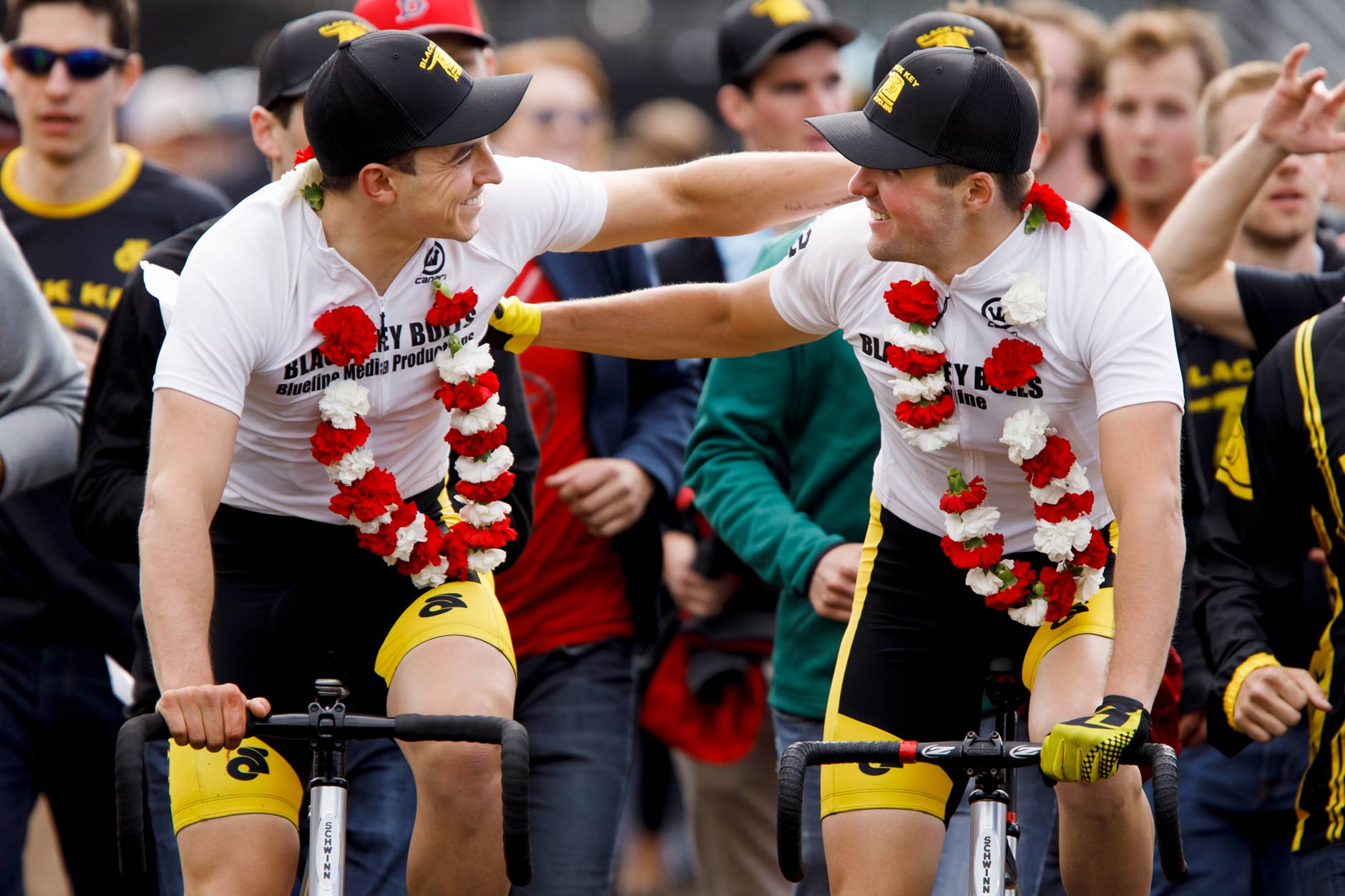 Black Key Bulls riders Xavier Martinez, left, and Charlie Hammon share a moment on the team's victory lap after winning the Men's Little 500 at Bill Armstrong Stadium on Saturday, April 22, 2017. (James Brosher/IU Communications)