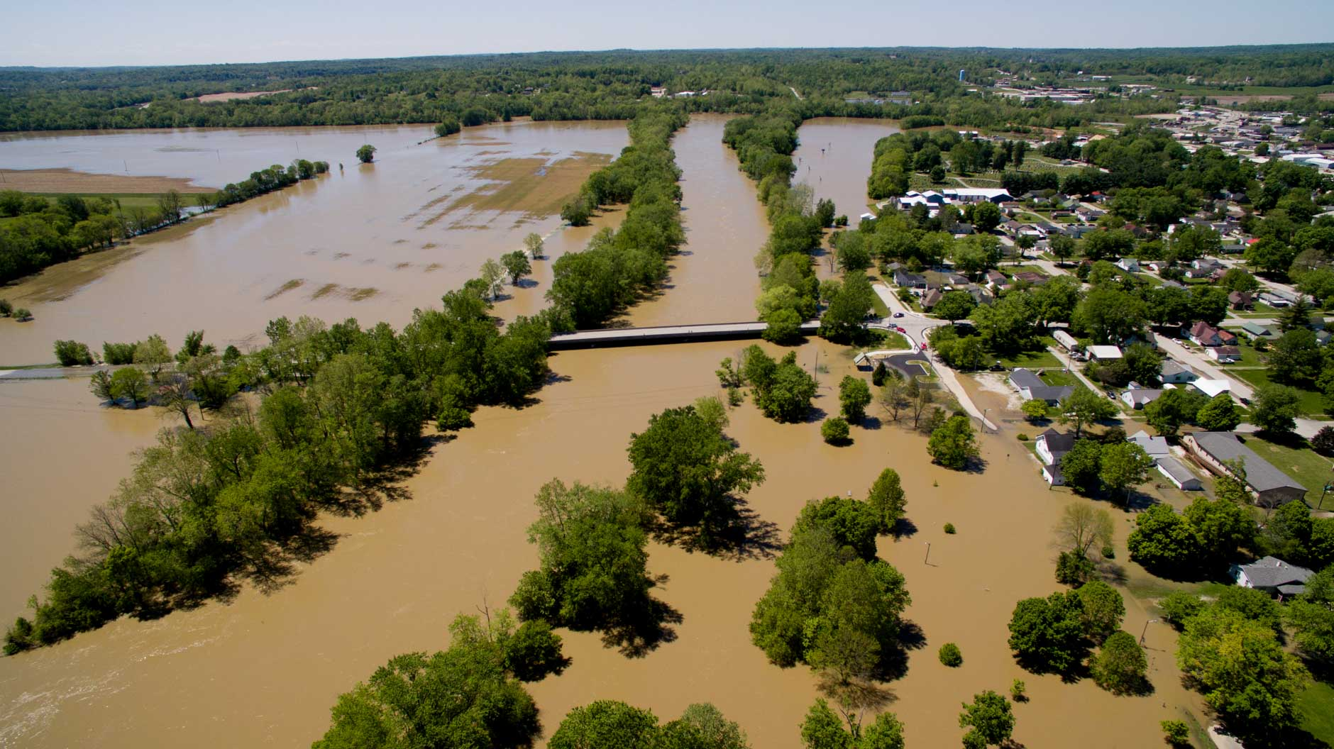 Flooding is pictured looking west along the White River near Cooper's Commons park in Spencer, Indiana on Sunday, May 7, 2017. The Old Ellettsville Road bridge is pictured at center. (Photo by James Brosher)