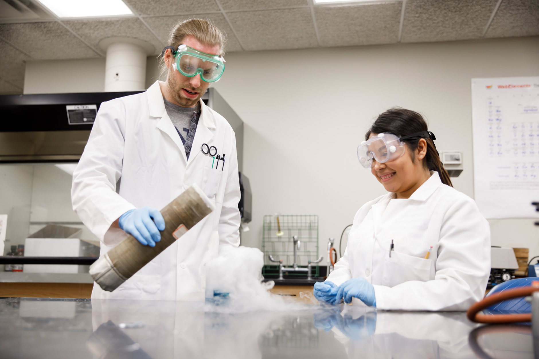 Indiana University Northwest Assistant Professor of Chemistry Ian Taschner, left, works with Gabriela Jaimes, a graduating senior, on an experiment in a lab on Tuesday, March 20, 2018. (James Brosher/IU Communications)