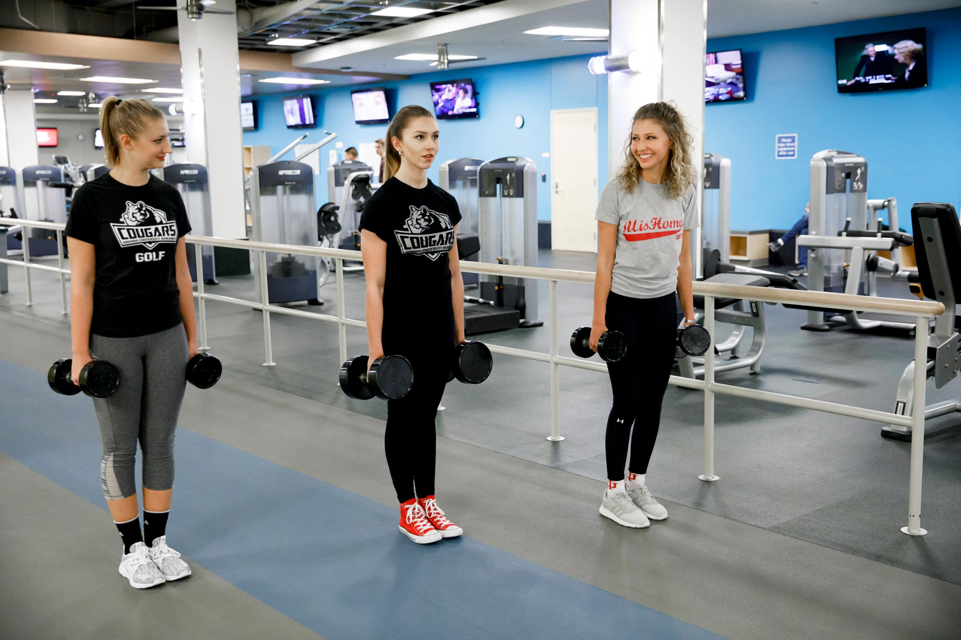 Bailey Troutman, right, a graduating senior, works out with her sisters, Brooke, left, and Brynna, in the Cole Family Wellness and Fitness Center at IU Kokomo on Wednesday, March 21, 2018. (James Brosher/IU Communications)