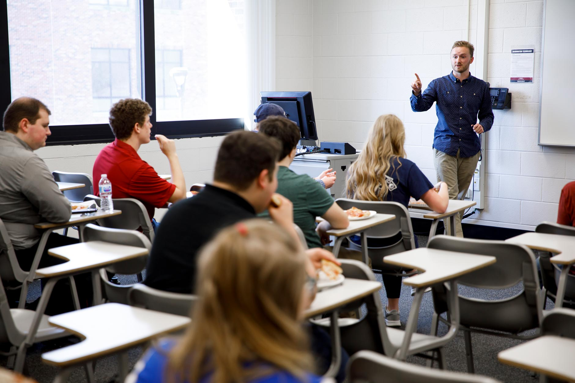 Roger Howard, a graduating senior at IU Southeast, directs a meeting of the Indiana University Southeast College Republicans on campus on Tuesday, April 3, 2018. (James Brosher/IU Communications)