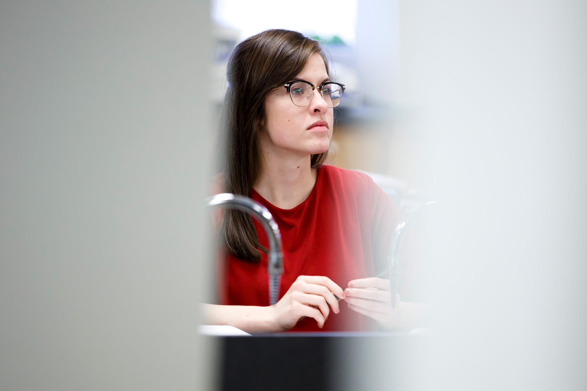 Emily Edwards, a graduating senior at IUPUC, listens during a Biology class on Thursday, April 5, 2018. (James Brosher/IU Communications)