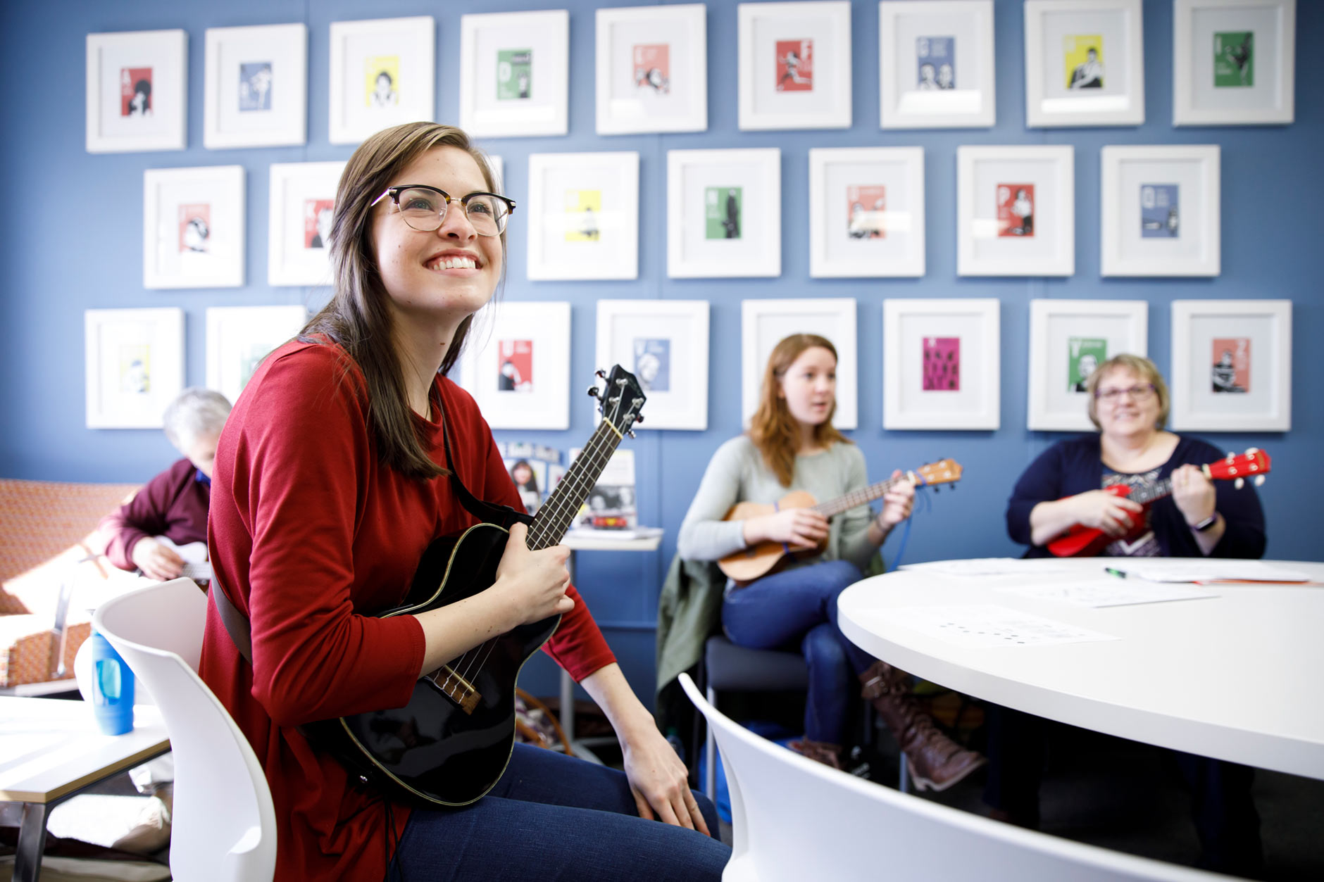 Emily Edwards, a graduating senior at IUPUC, shares a smile as she prepares for a ukulele club meeting on campus in Columbus on Thursday, April 5, 2018. (James Brosher/IU Communications)