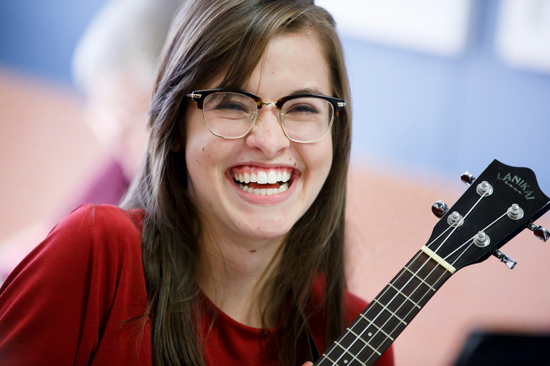 Emily Edwards, a graduating senior at IUPUC, laughs as she participates in a ukulele club meeting on campus in Columbus on Thursday, April 5, 2018. (James Brosher/IU Communications)