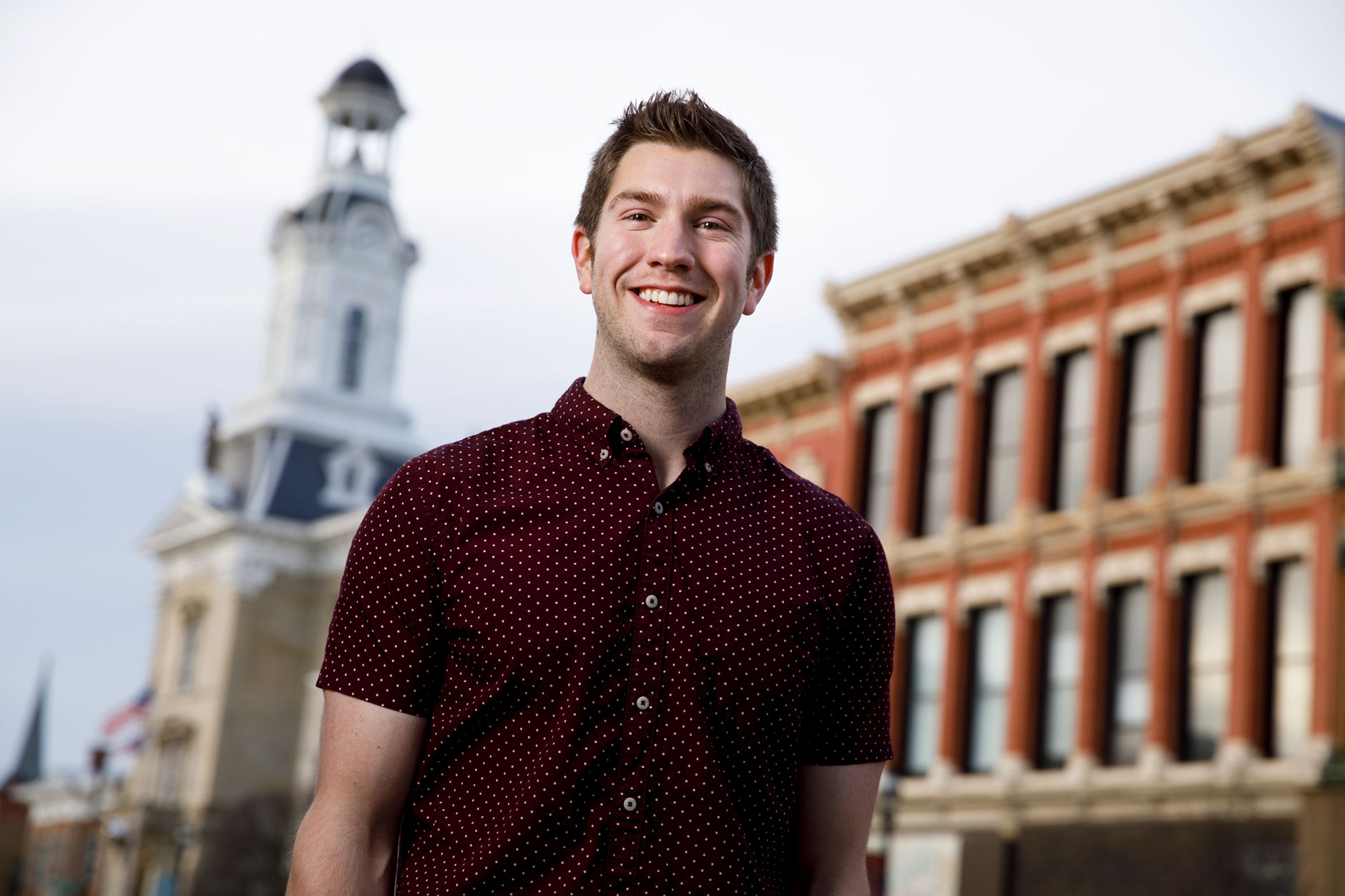 Justin Westfall, a graduating IU Online student, poses for a portrait in downtown Greenville, Ohio on Friday, April 6, 2018. (James Brosher/IU Communications)