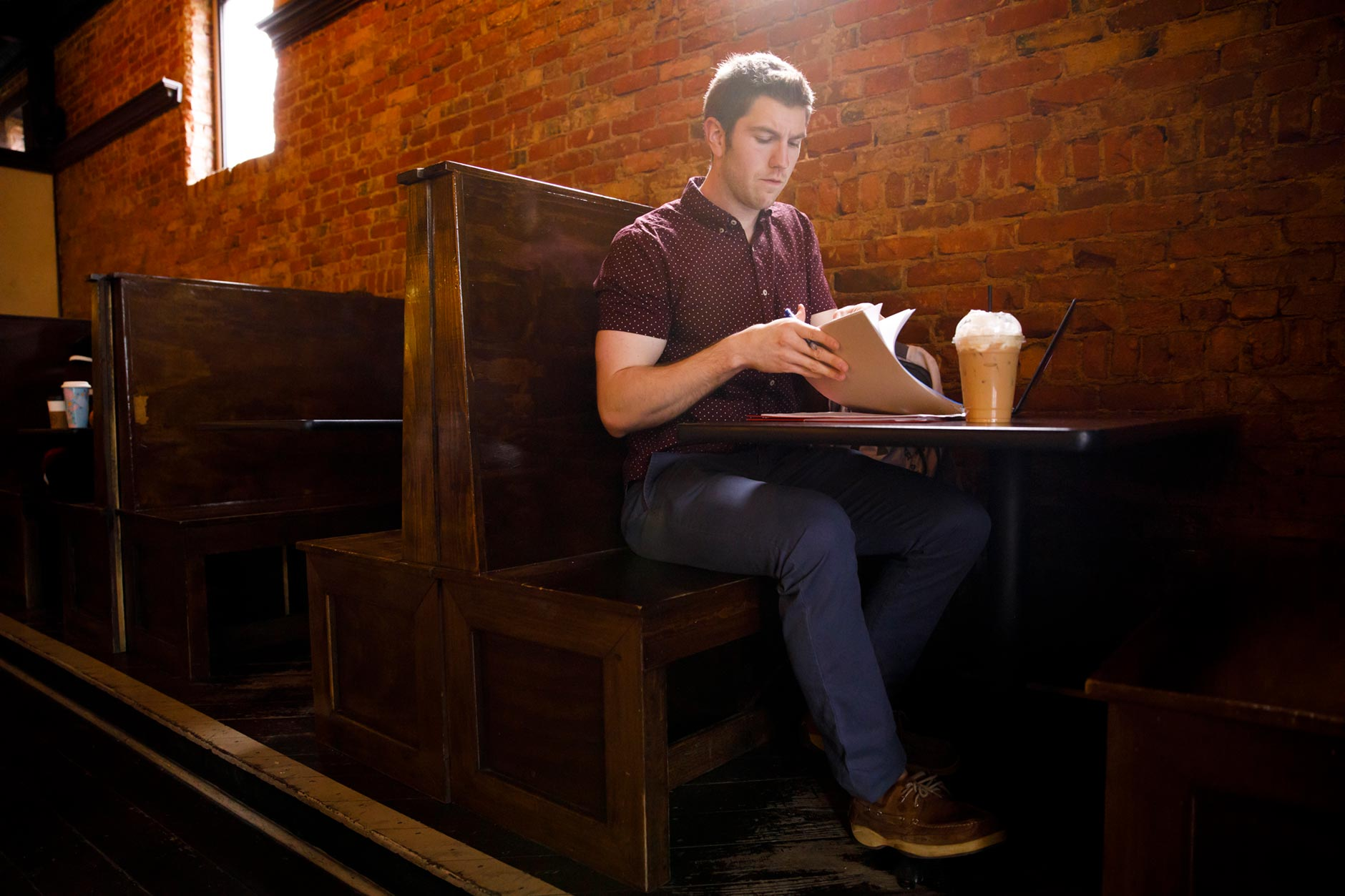 Justin Westfall, a graduating IU Online student, works on homework at the Coffee Pot in Greenville, Ohio on Friday, April 6, 2018. (James Brosher/IU Communications)