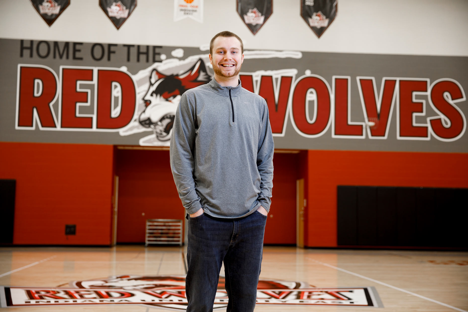 Lucas Huffman, a graduating senior at IU East, poses for a portrait on the court at the campus' Student Activity Center in Richmond on Friday, April 6, 2018. (James Brosher/IU Communications)