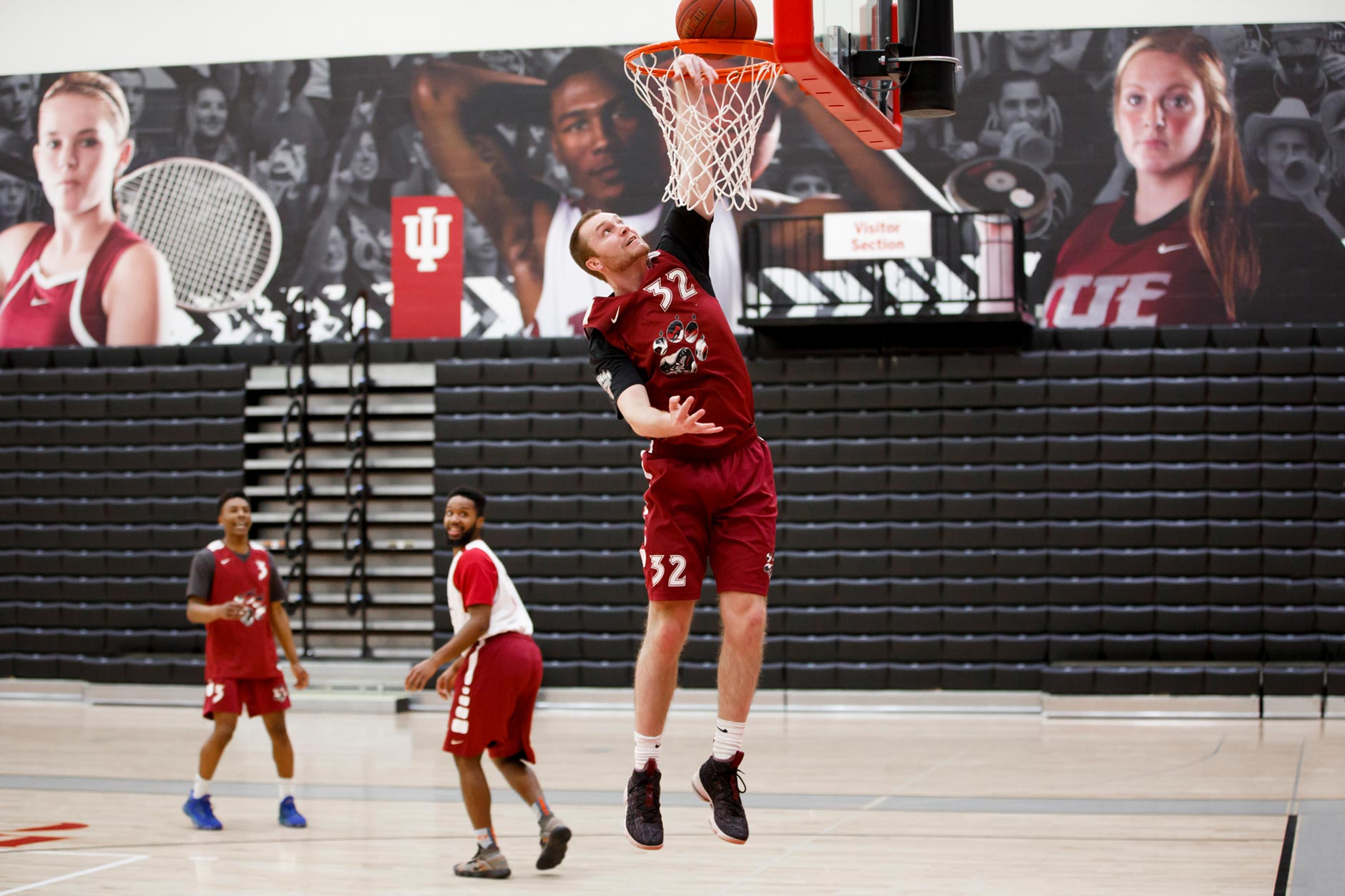 Lucas Huffman, a graduating senior at IU East, dunks in a pick-up basketball game with teammates at the Student Activity Center in Richmond on Friday, April 6, 2018. (James Brosher/IU Communications)