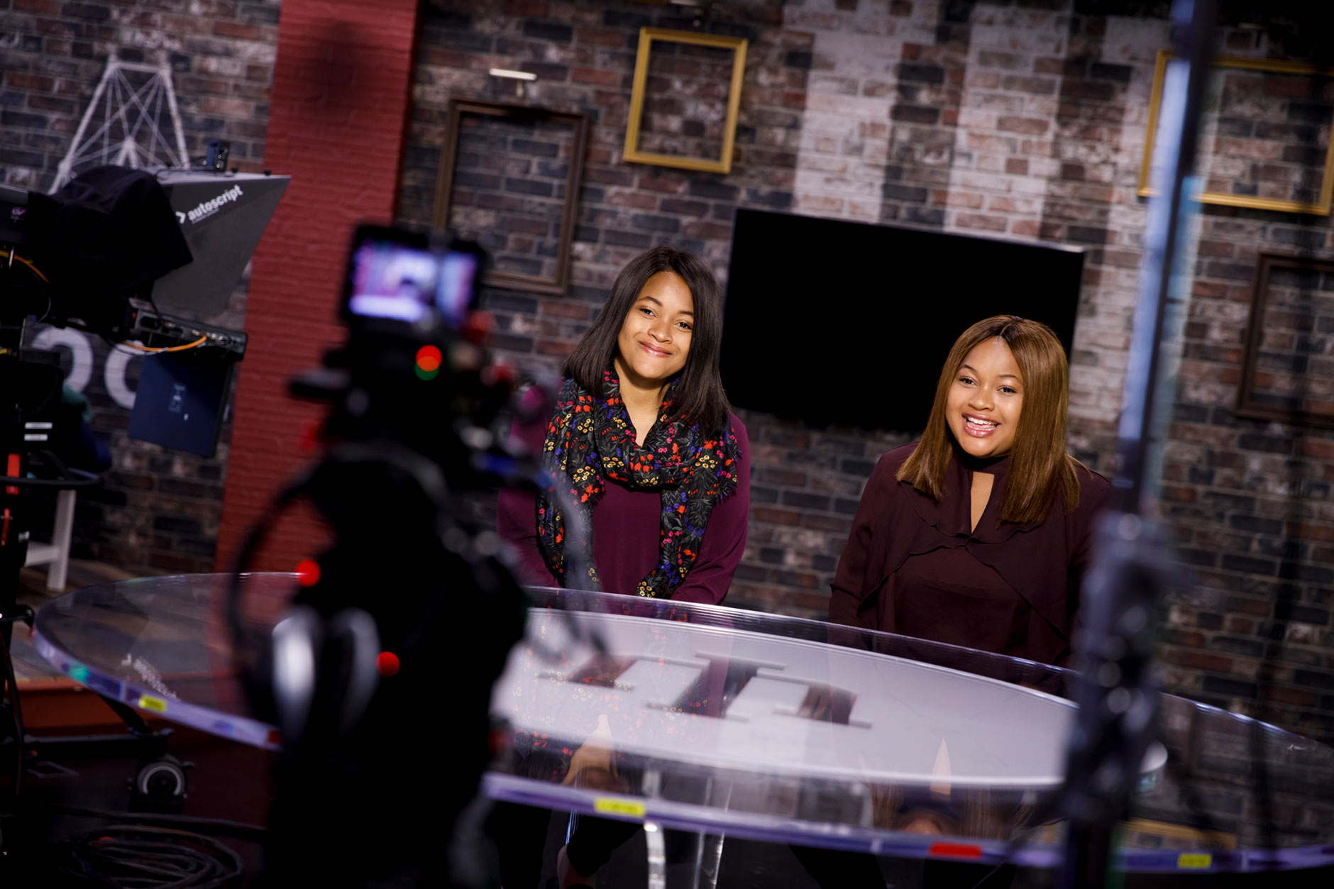Sisters Mica, left, and Maya Caine, graduating seniors at IU Bloomington, record a video in a studio at The Media School at Indiana University on Tuesday, April 10, 2018. (James Brosher/IU Communications)