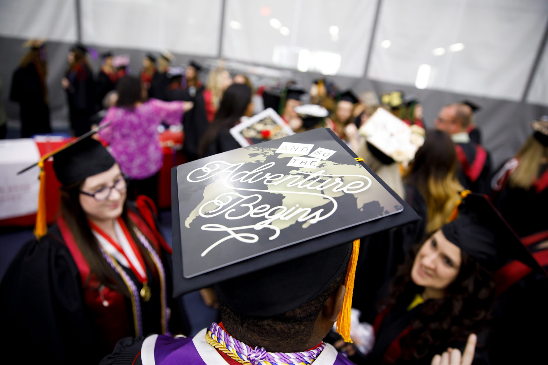 Desmond Atem wears a decorated mortarboard before the Indiana University South Bend Commencement at the University of Notre Dame on Tuesday, May 8, 2018. (James Brosher/IU Communications)
