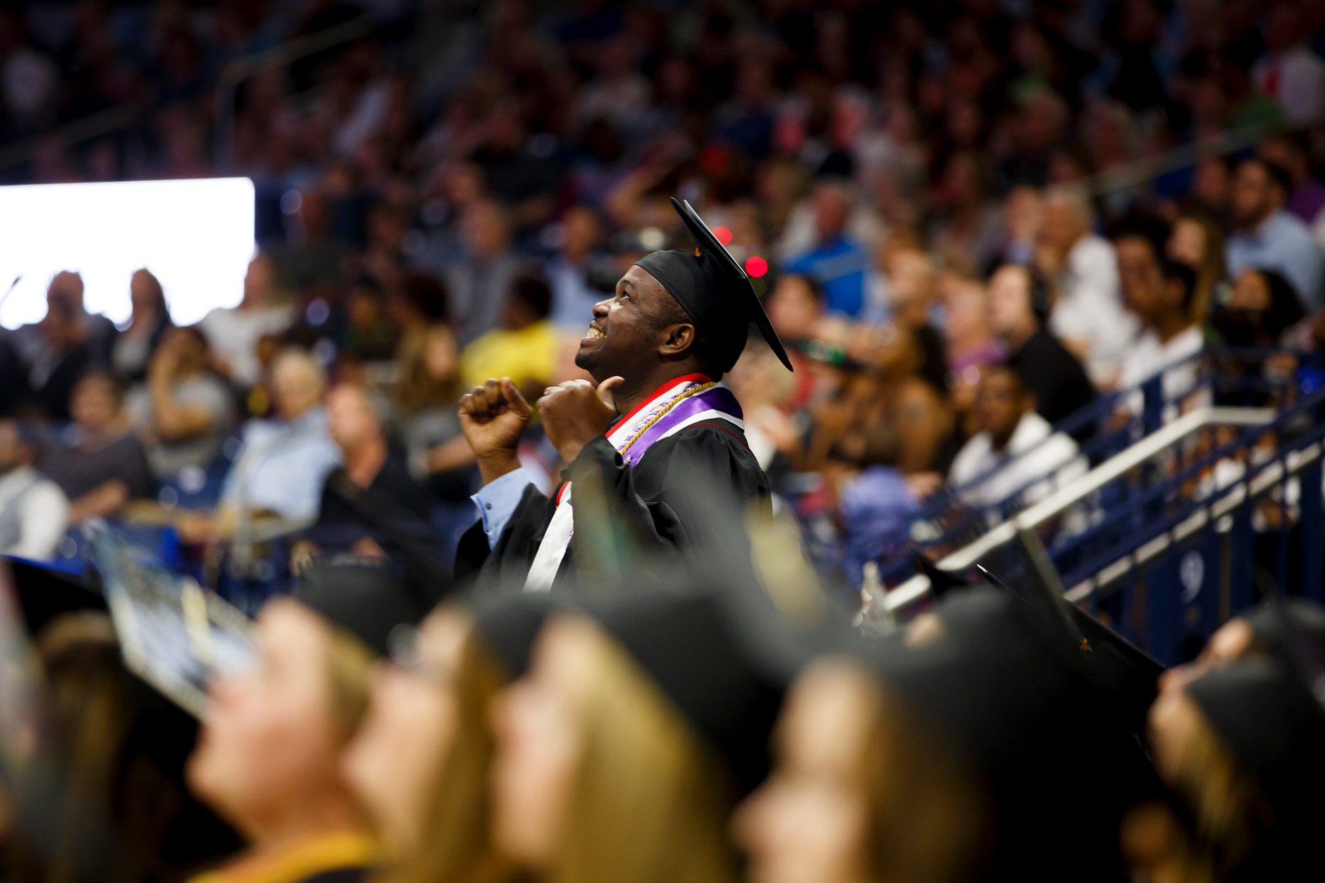 Graduate Desmond Atem reacts as he is recognized by Indiana University South Bend Chancellor Terry L. Allison during the IU South Bend Commencement at the University of Notre Dame on Tuesday, May 8, 2018. (James Brosher/IU Communications)