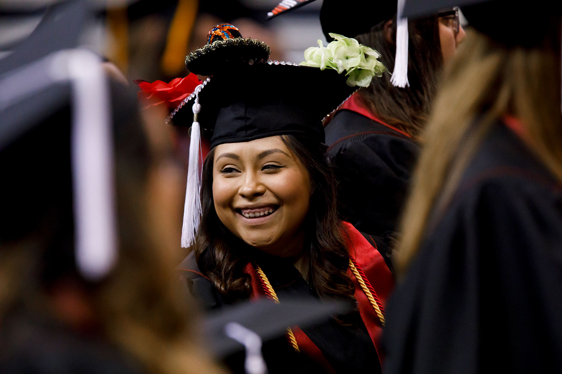 Graduate Gabriela Jaimes shares a smile as she stands with fellow graduates during the conferral of degrees at the IU Northwest Commencement at the Genesis Convention Center in Gary on Thursday, May 10, 2018. (James Brosher/IU Communications)