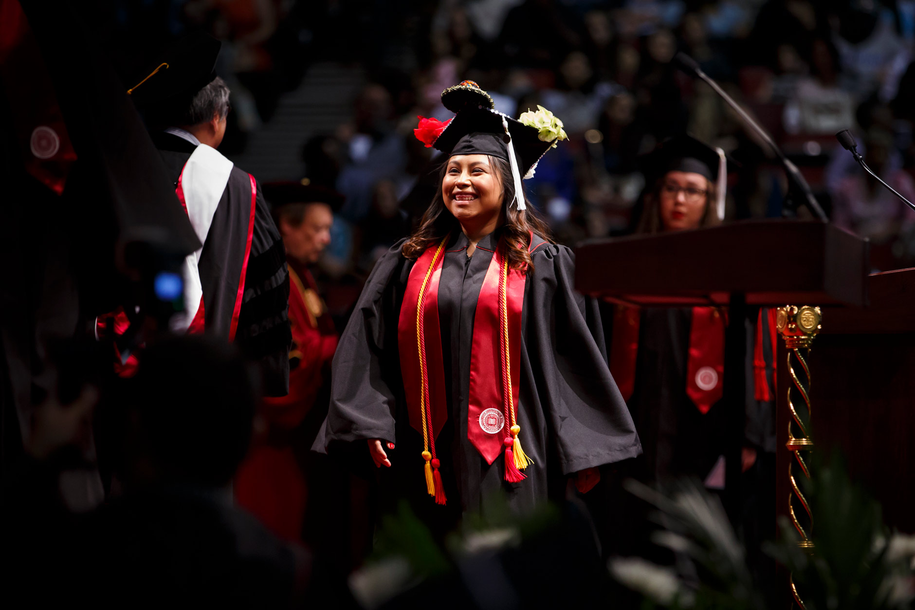 Graduate Gabriela Jaimes walks across the stage to receive her degree during the Indiana University Northwest Commencement at the Genesis Convention Center in Gary on Thursday, May 10, 2018. (James Brosher/IU Communications)
