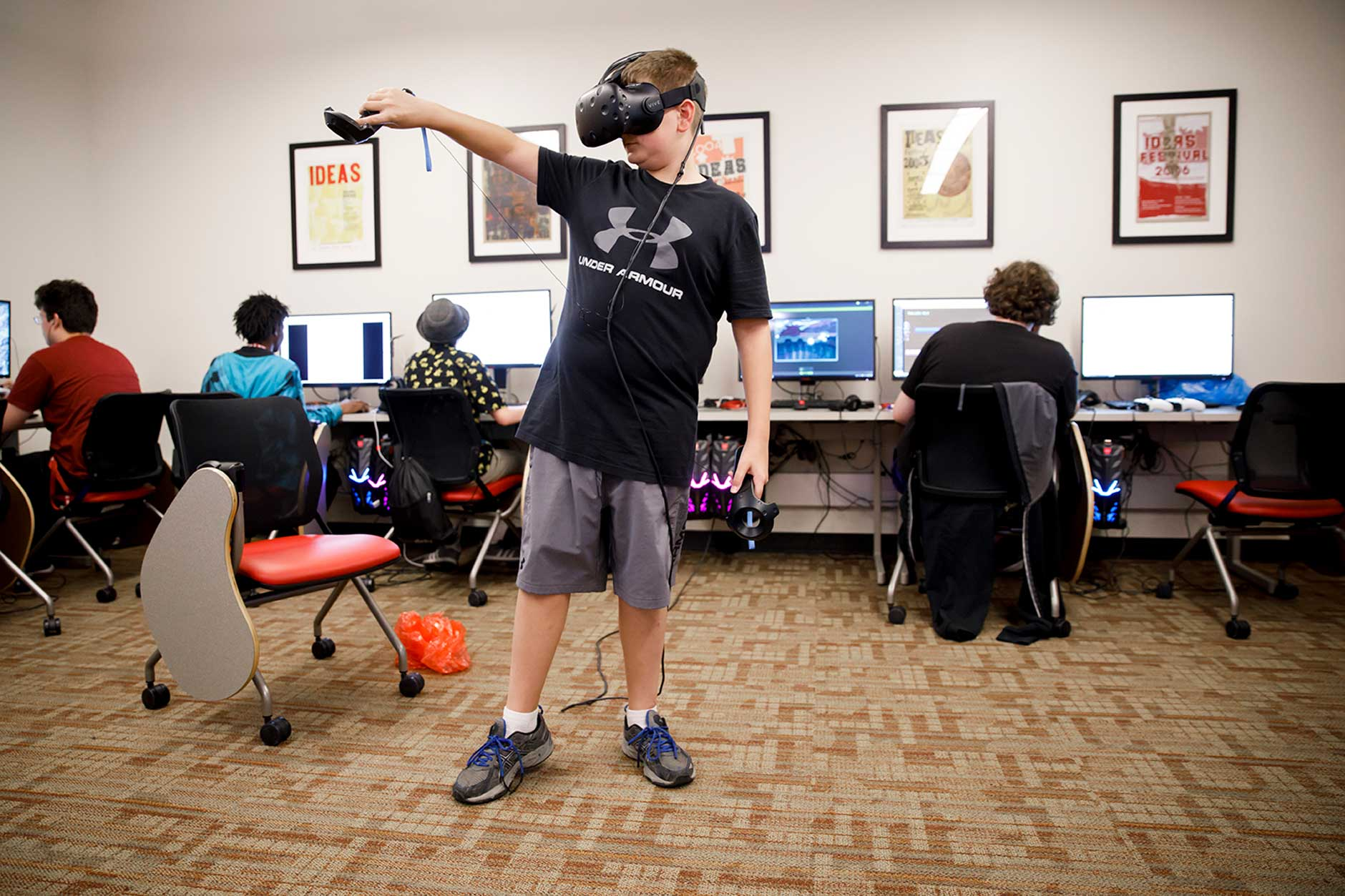 Sam Sylvester plays a game in virtual reality during the Game Development Camp at the Indiana University Media School on Thursday, June 21, 2018. (James Brosher/IU Communications)