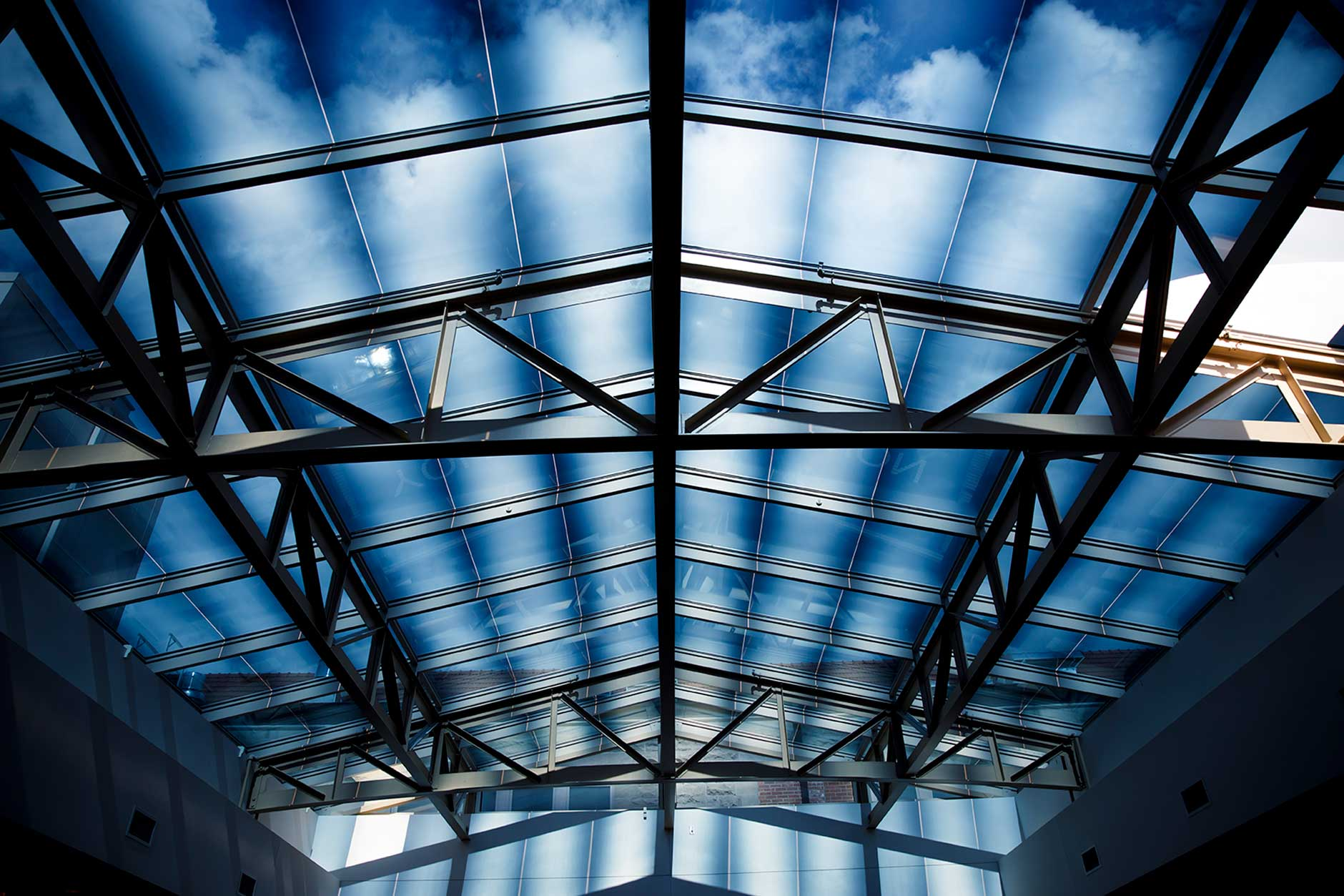 Clouds float over the atrium above Franklin Hall during the Game Development Camp at the Indiana University Media School on Friday, June 22, 2018. (James Brosher/IU Communications)