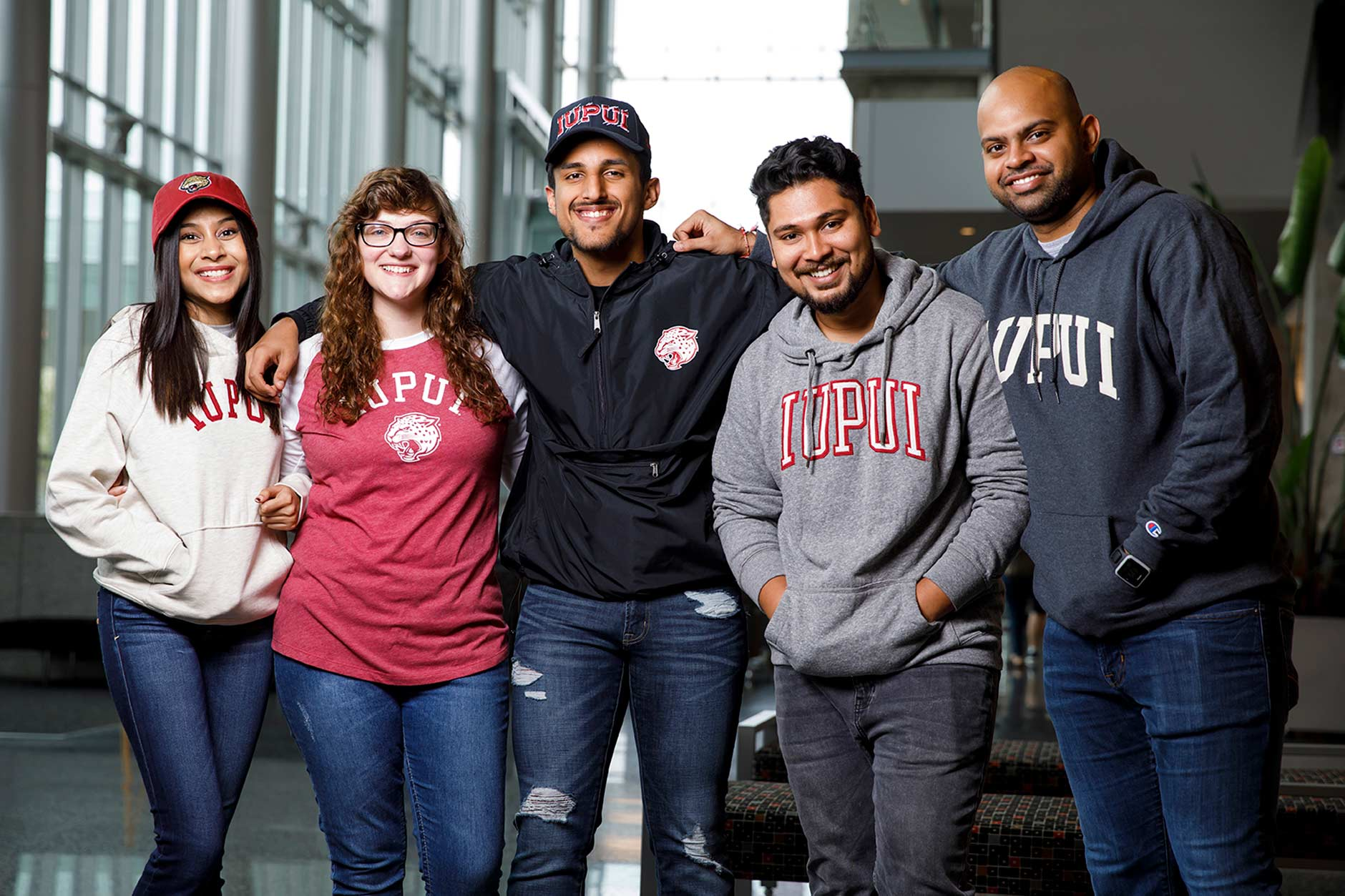 IUPUI students Naeema Patel, left, Miranda Williams, Joshua Khan, Harshal Dhamade and Karan Patel pose for a group photo during an IUPUI apparel fashion photo shoot at the Campus Center on Wednesday, Aug. 8, 2018.