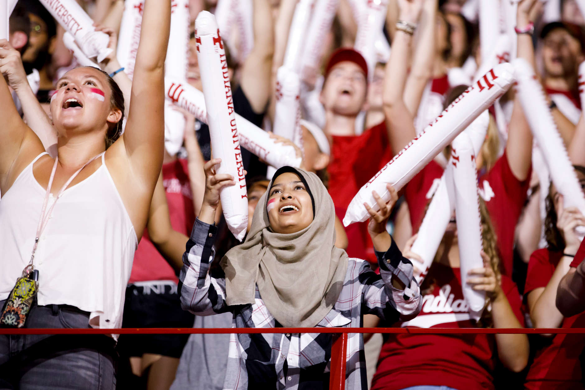 A student claps inflatable noise sticks together during the Traditions and Spirit of IU at Assembly Hall on Friday, Aug. 17, 2018. (James Brosher/IU Communications)
