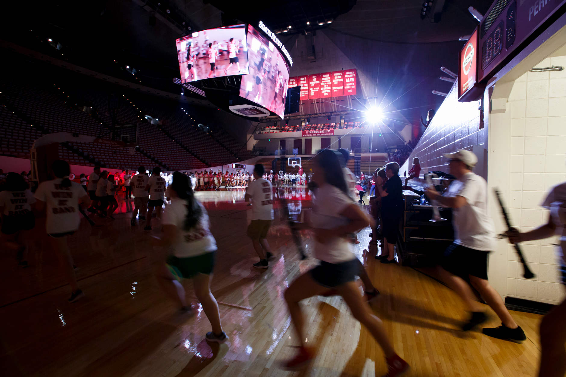 Members of the Indiana University Marching Hundred run onto the court during the Traditions and Spirit of IU at Assembly Hall on Friday, Aug. 17, 2018. (James Brosher/IU Communications)
